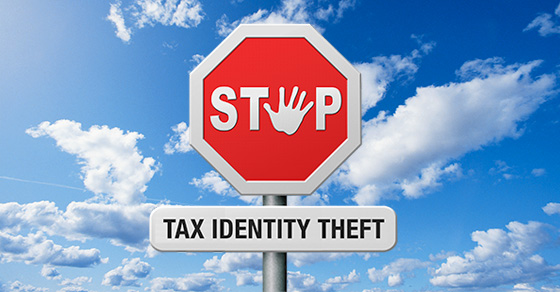 "Image of a stop sign with a hand print as the ""o"". Under the stop sign is a sign that reads tax identity theft."