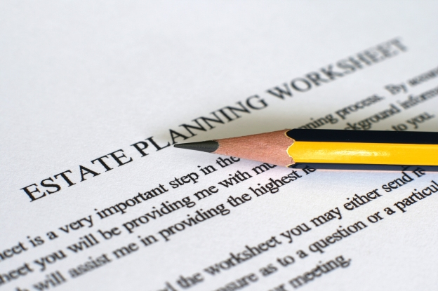 Image is of a sheet of paper with the words Estate plan sheet typed on it and a pencil sitting on the paper,
